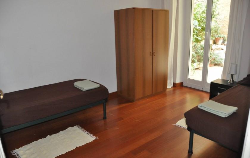 Location de vacances - Appartement à Ospedaletti - chambre avec deux lits