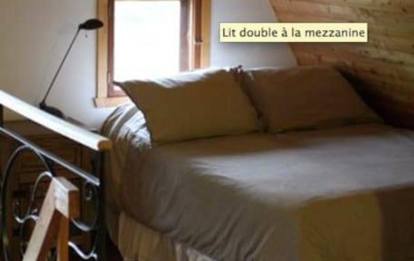 Location de vacances - Chalet à Les Éboulements - Lit Double