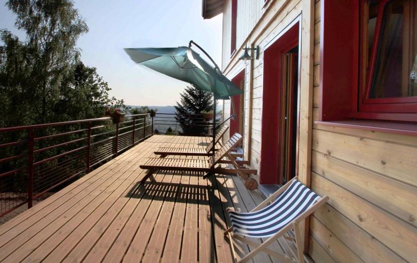 Location de vacances - Chalet à Le Tholy - Le soir sur le balcon