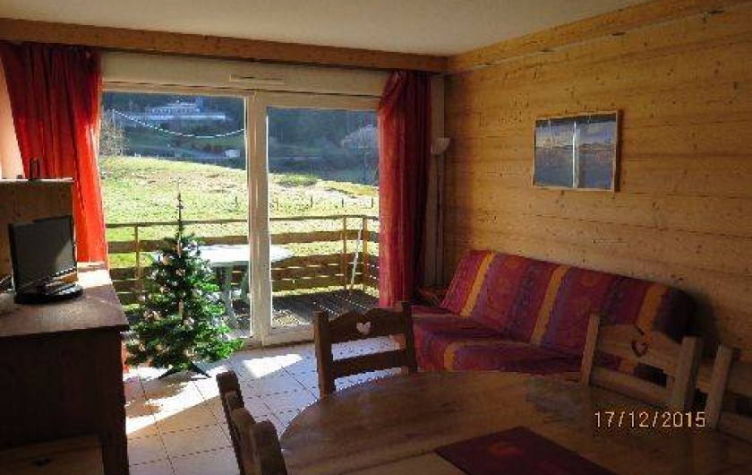 Location de vacances - Appartement à Gérardmer - Séjour avec clic-clac