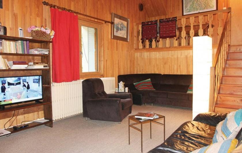 Location de vacances - Appartement à Le Monêtier-les-Bains - Salon coté télé au fond le coin lecture