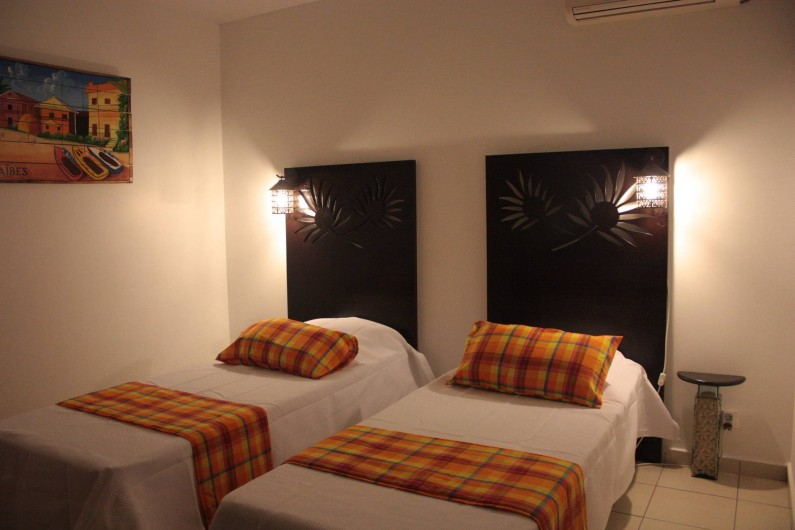Location de vacances - Villa à Saint-François - Chambre Les Saintes 2 lits séparés OU 1 grand lit Queen size au choix