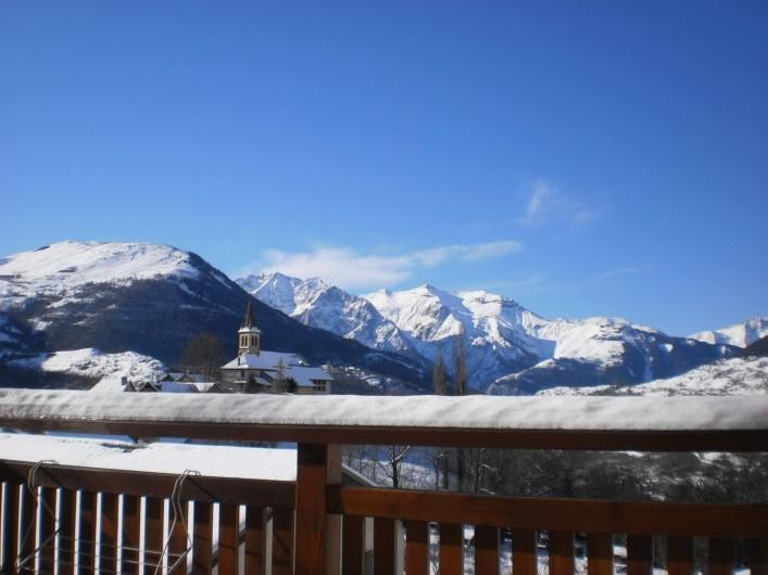 Location de vacances - Chalet à Mizoën - vue de la terrasse l' hiver