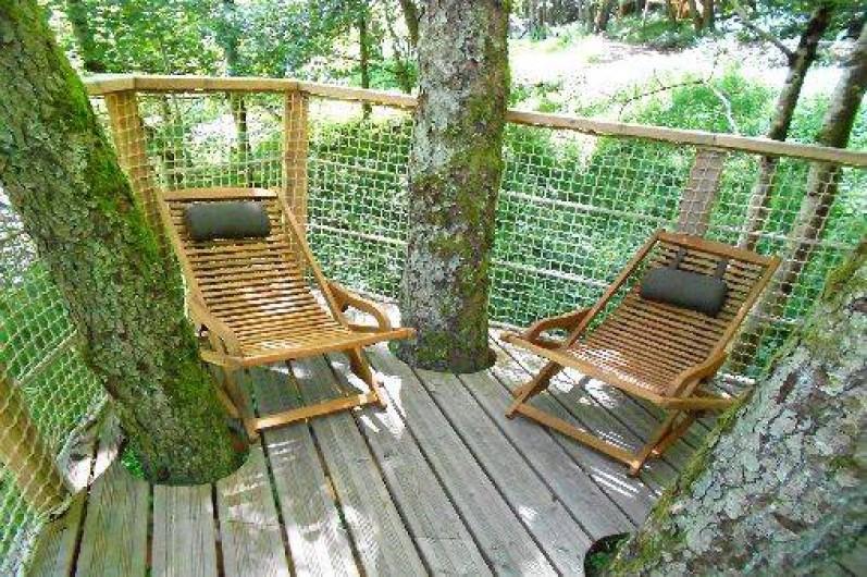"""Location de vacances - Cabane dans les arbres à Grandfontaine - Terrasse Cabane Couple (2 couchages) """"Le Petit Toit du Monde"""""""