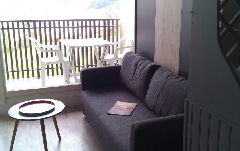 Location de vacances - Studio à Gérardmer - banquette  salon