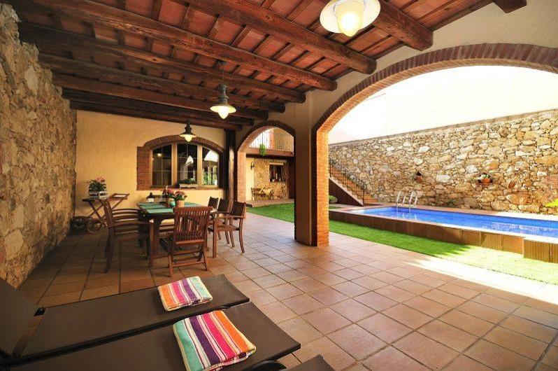 Location de vacances - Mas à Sant Antoni de Calonge - Porche à côté de la piscine